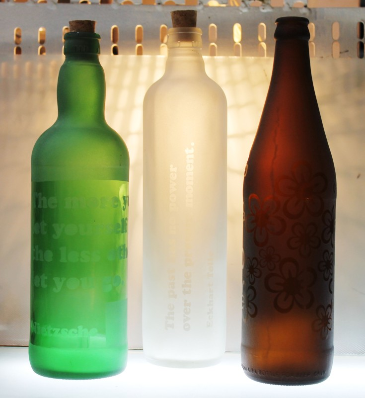 Sand-blasted, upcycled bottle product